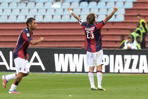 Bologna player Alessandro Diamanti celebrates after scoring the opening goal against Udinese