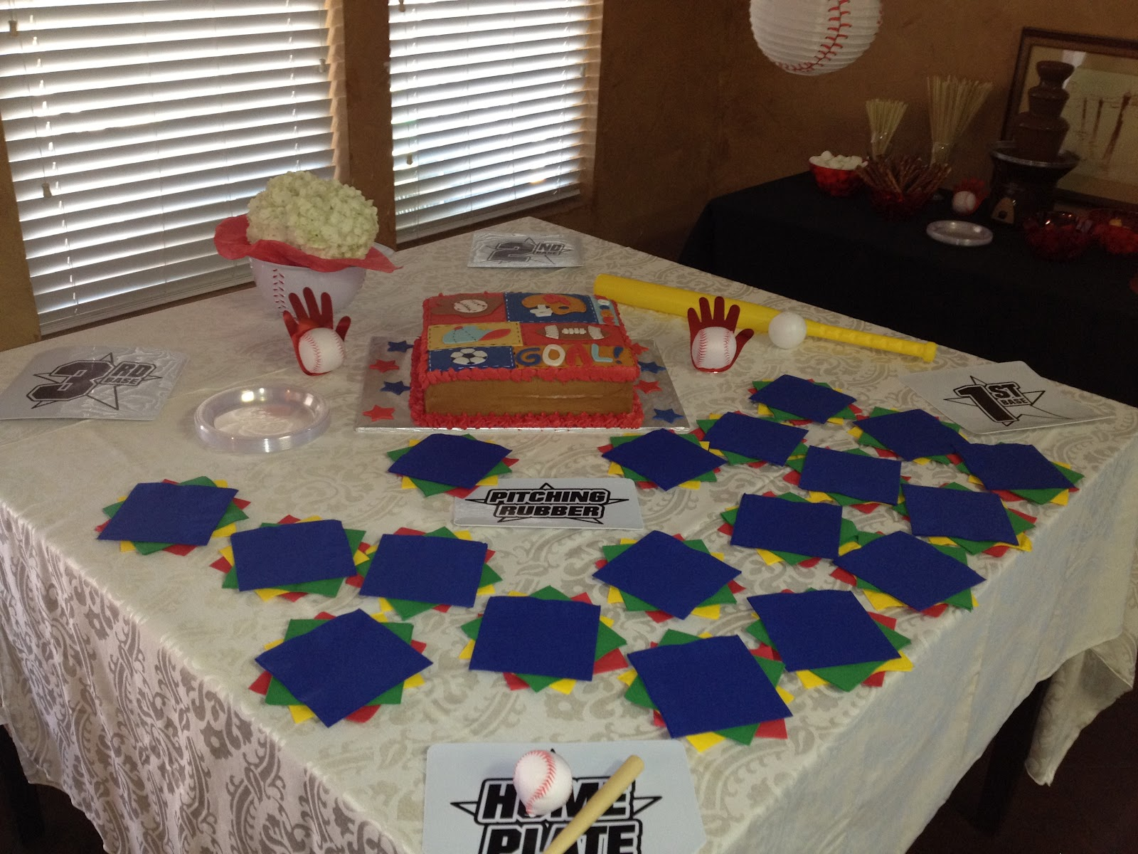 the cake table was decorated like a baseball diamond easy i