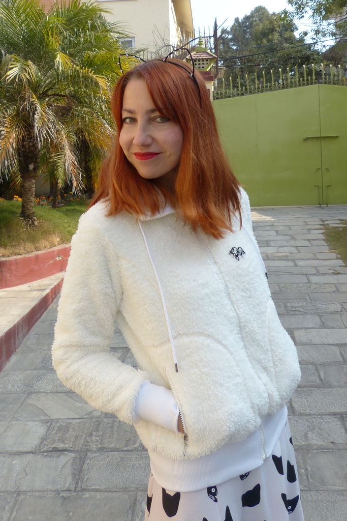 White fur effect jacket and cat ears headpiece