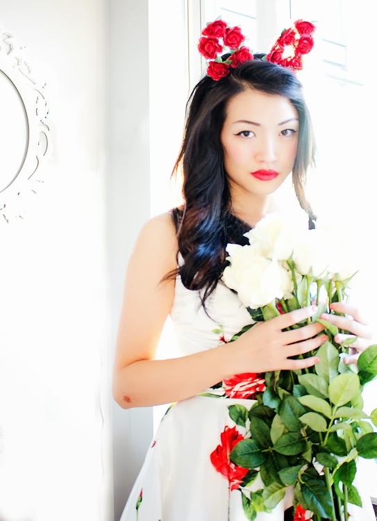Vancouver Fashion blogger Jasmine Zhu wearing garden bunny ears and floral 50s dress