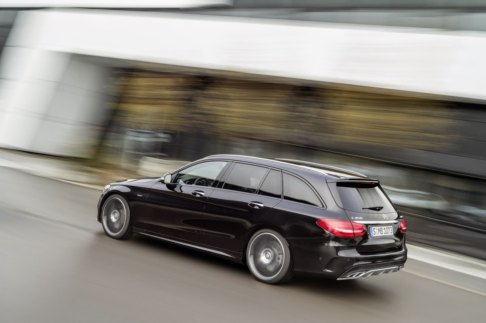 Mercedes Benz C450 AMG moving rear angle