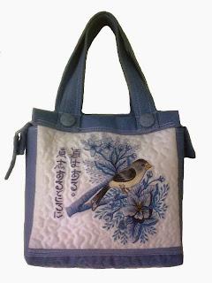 bird embroidered handbag