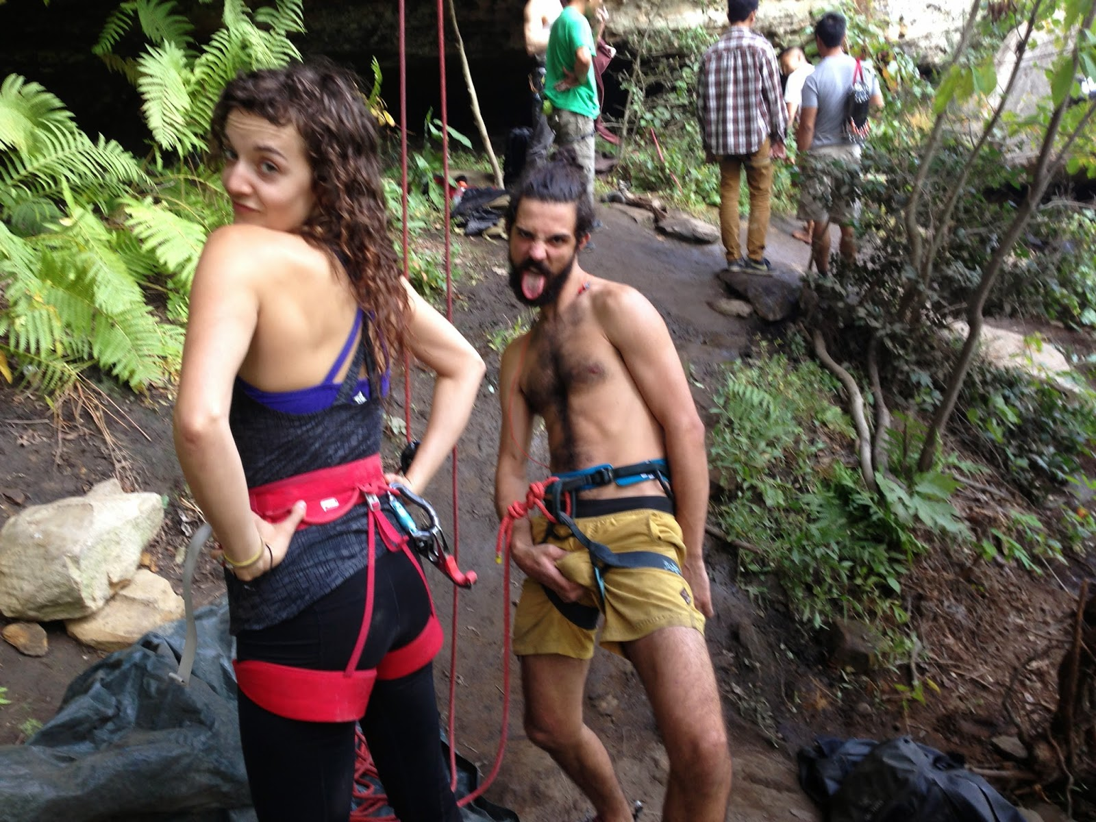 Rock climbing in harness naked