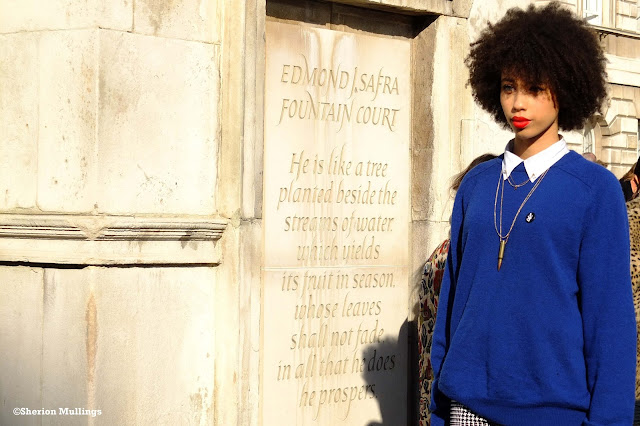 Pippa Christian at lfw wearing a blue jumper and red lips