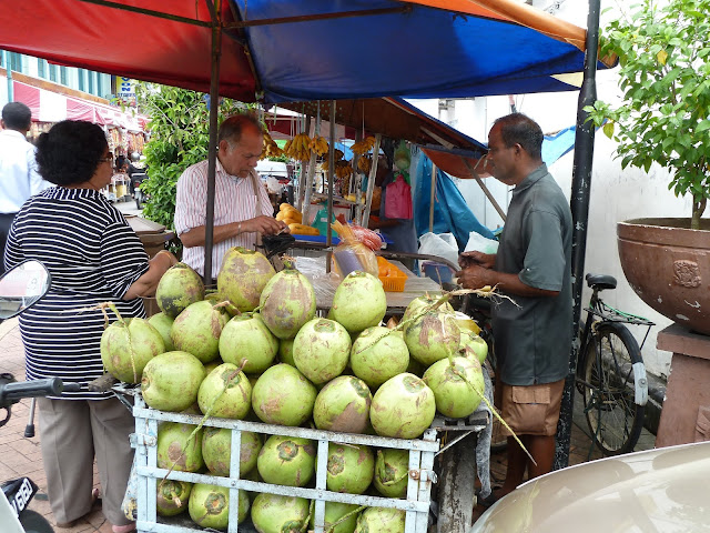 Selling fresh green coconuts in Little India, Penang