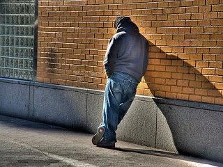 A sad homeless teenage kid on the street.