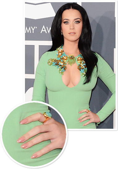 ... Lopez's chic gold, pointed nails were as blinged out as her jewelry