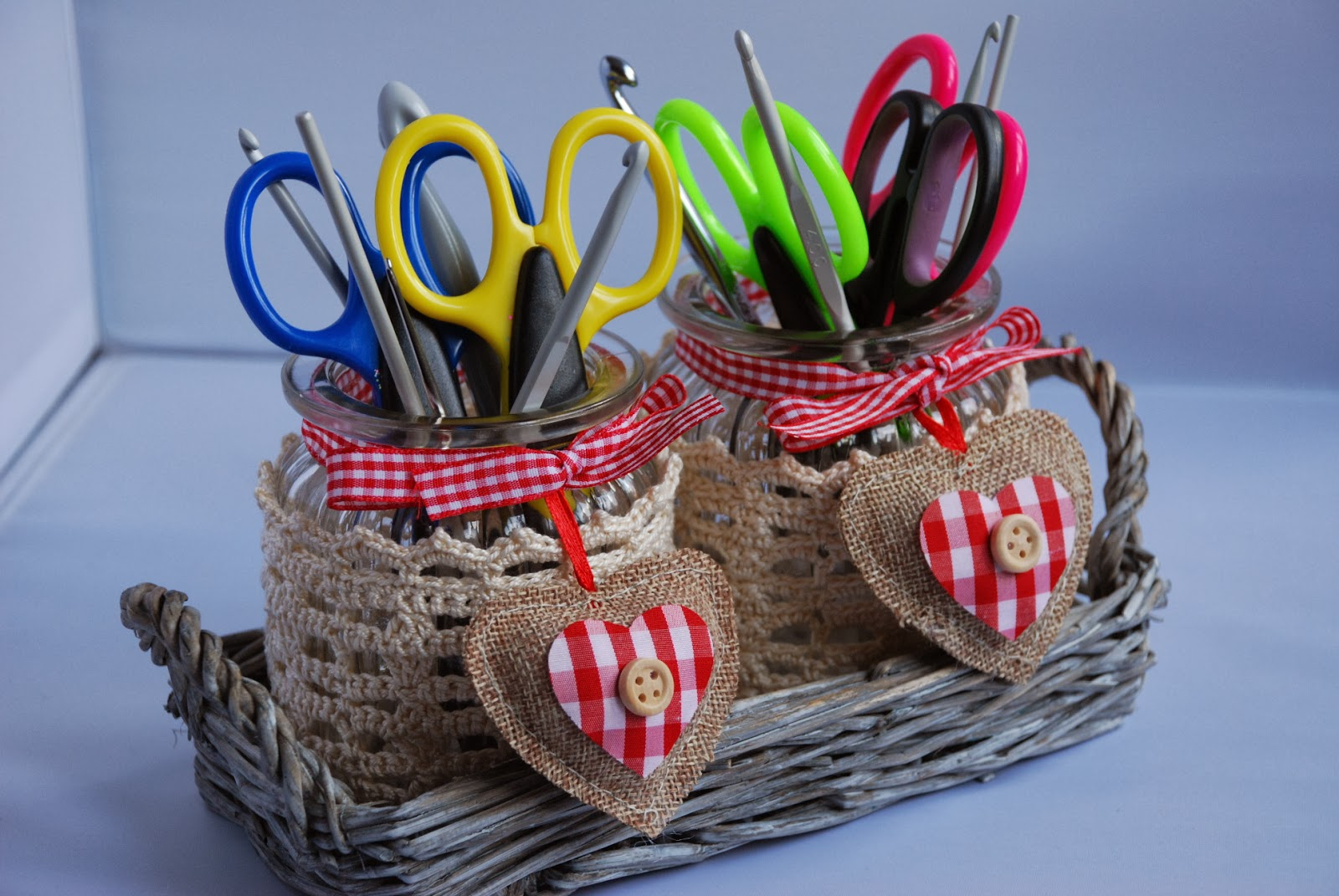 image of crochet cosy jars with crochet hooks and scissors inside