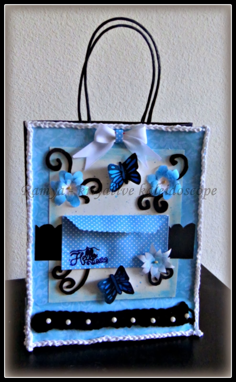 Kriya tive kaleidoscope hand decorated gift bag with a cute envelope now when i saw the theme of many challenges being decorated gift bag i decided to recycle that paper bag into a gift bag negle Gallery