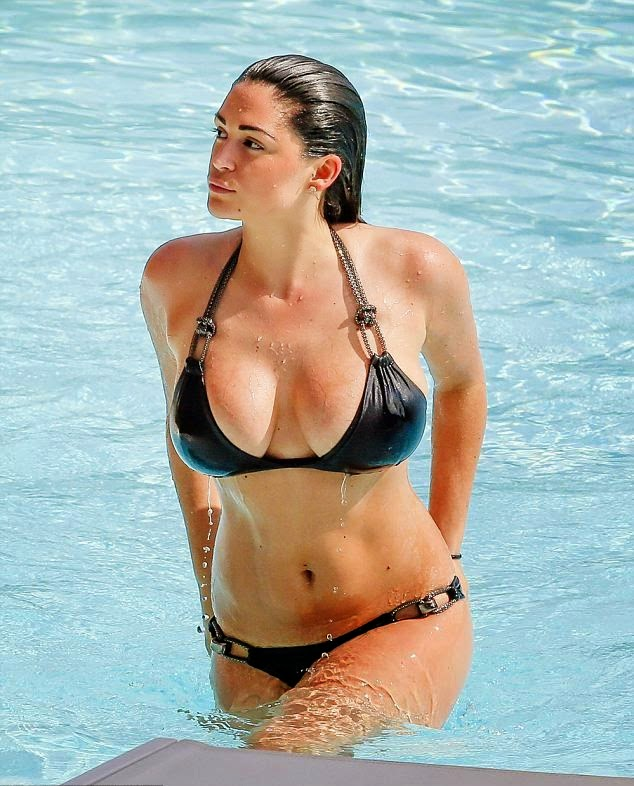 The‭ ‬29-year-old, Casey Batchelor's certainly didn't one to shy away from displaying her incredible figure both on and off at the hotel poolside in Portugal on Saturday,‭ ‬May‭ ‬10,‭ ‬2014.