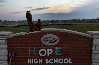 Joplin high school sign with missing letters replaced with tape to spell hope