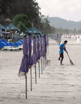 Sweeping up at Karon Beach