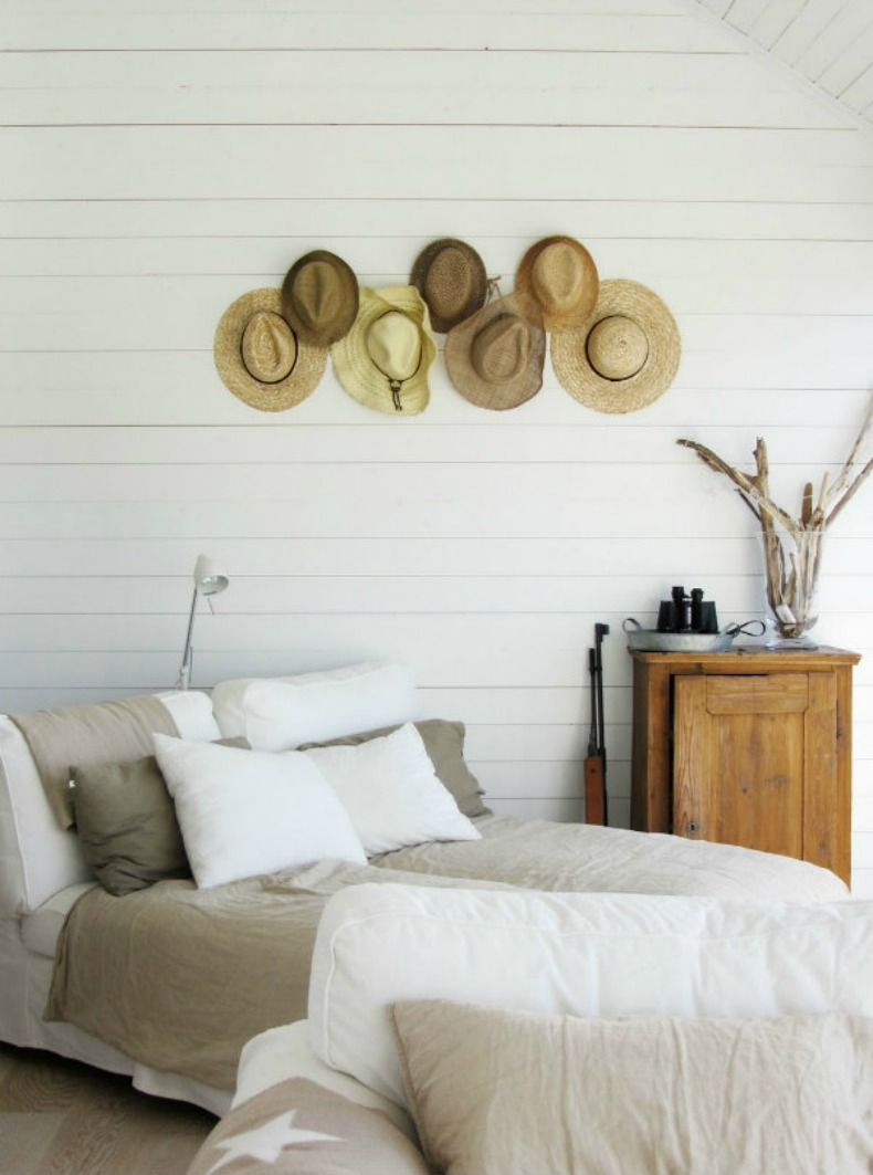 Coastal wall display of hats in a bedroom