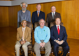 Dr. Steven Cuvelier (seated, far right) has been a member of the faculty for 25 years.