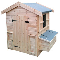 chicken shed with outside nest boxs and sliding bob hole