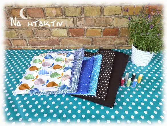 Stoffe Birnen Punkte blau Streublümchen Jersey schwarz Baumwolle Garnrollen Amann