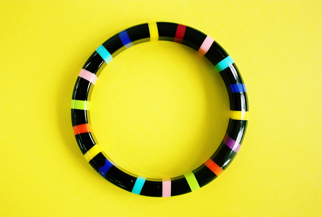 bracelet with coloured rings on yellow background