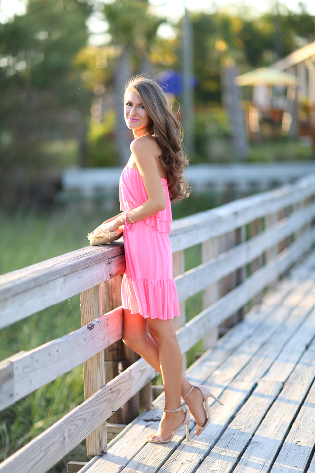 Pink ruffle dress at the beach