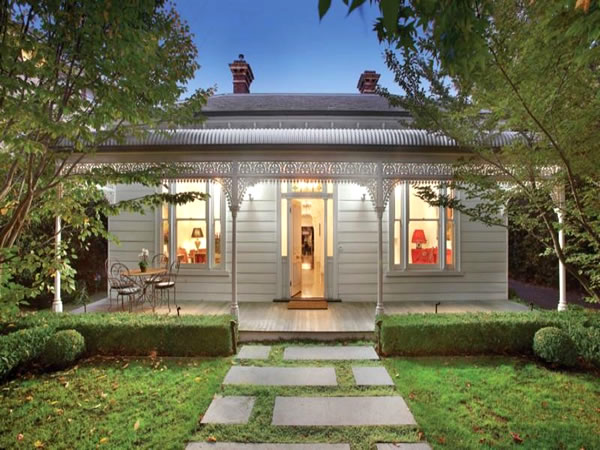 A black white cottage with a beautiful garden glamour drops Australia home and garden tv show