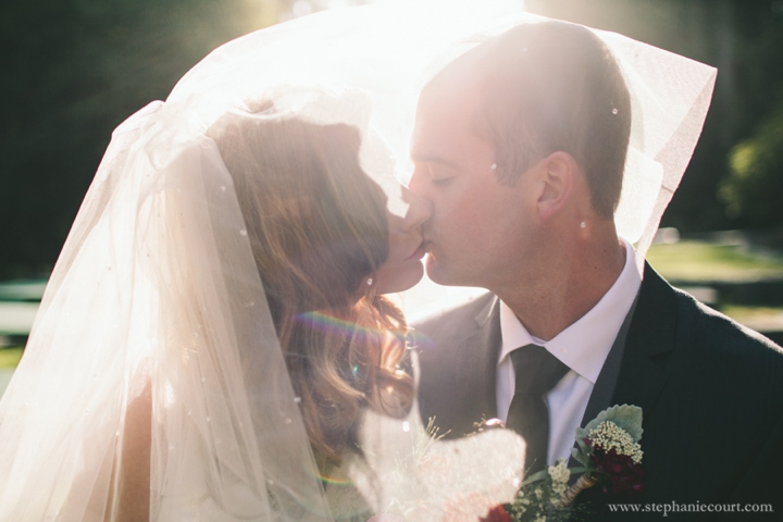 romantic backlit veil wedding photo