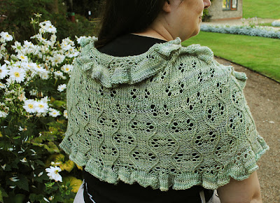 Garden Path moebius shawl / capelet with cables & lace