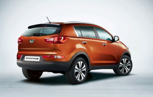 Rear 3/4 view of orange 2011 Kia Sportage