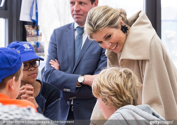 Queen Maxima of The Netherlands talks with students as she kicks of the Week of Money (Week van het Geld) at the OBS West Primary School on March 9, 2015 in Capelle aan den Ijssel, The Netherlands