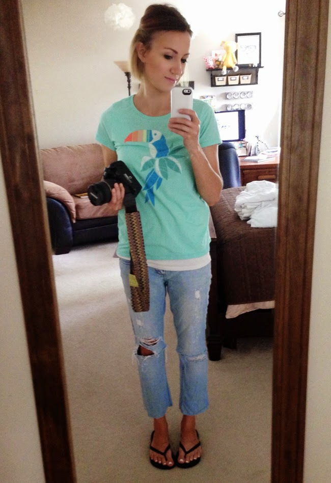 Tropical graphic tee and light destroyed jeans
