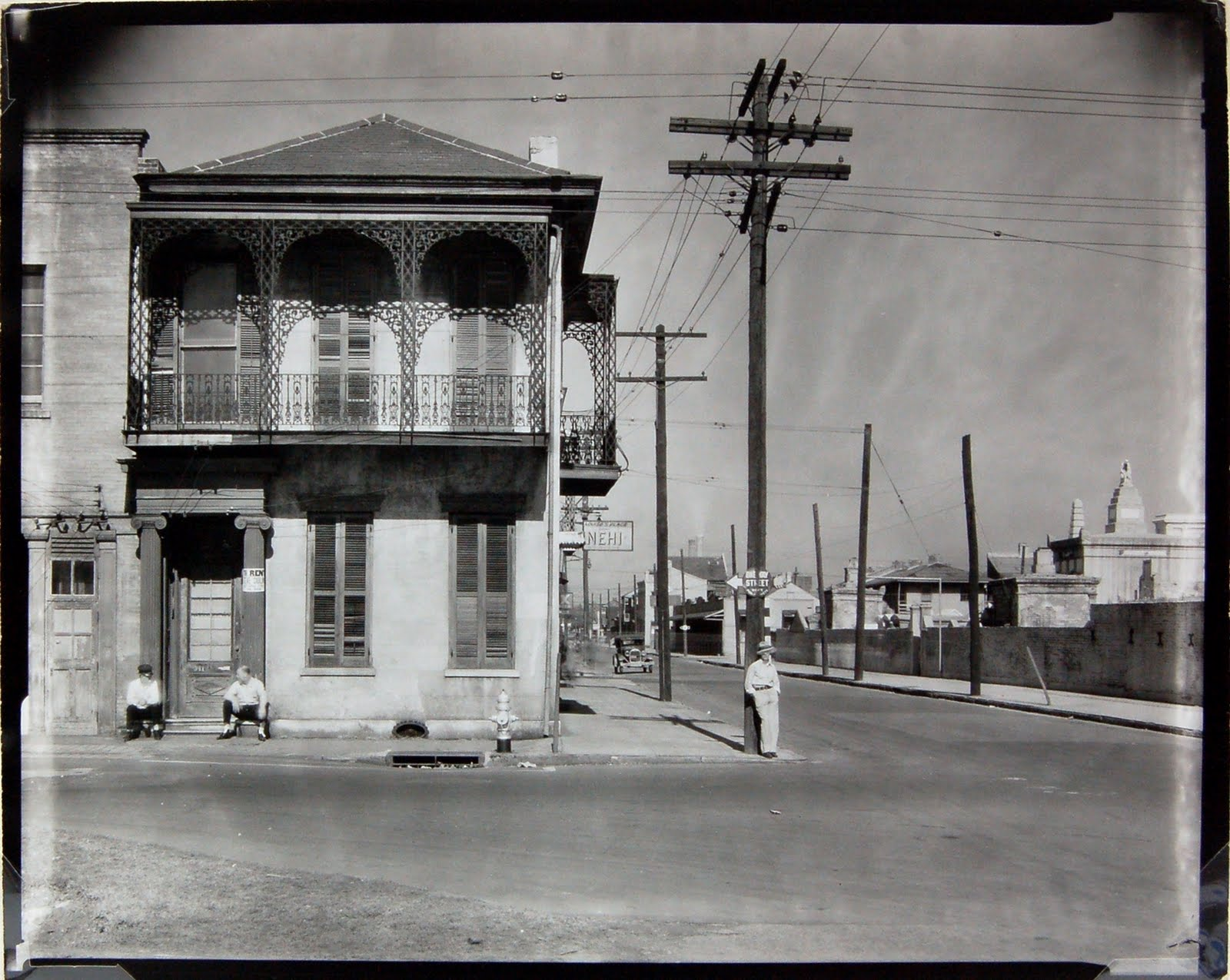 1935 Greek Revival Townhouse with Men Seated in Dourway, New Orleans