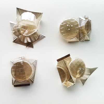 A series of four small assemblages made from chocolate box tray.