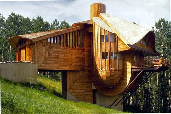 Coolest cabins not just 39 any 39 modern wood cabin for Wood cabin homes