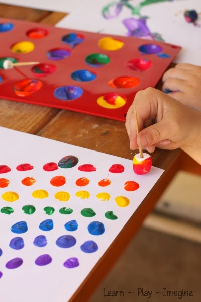 Painting rainbows with marshmallows learn play imagine for Imagine crafts craft mat