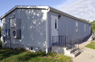 24' x 40' modular classrooms are used for 20 students and a teacher.