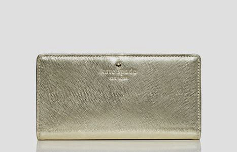 Kate Spade leather cherry lane stacy purse in gold with 14 karat gold-plated hardware