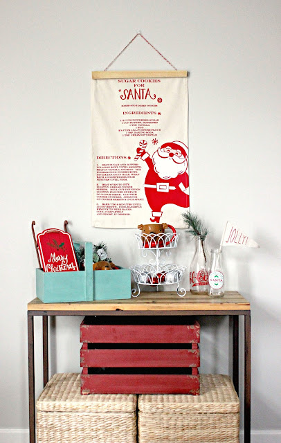 DIY Christmas Tea Towel Wall Banner. Only took 15 minutes and a few supplies to make!