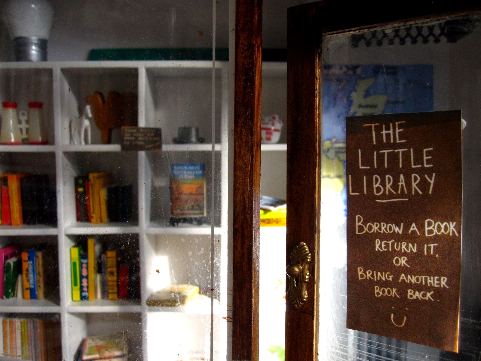 Entrance to a modern dolls' house miniature pop-up Little Library.