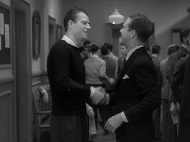 John Wayne in a bit part in College Coach 1933 with Dick Powell
