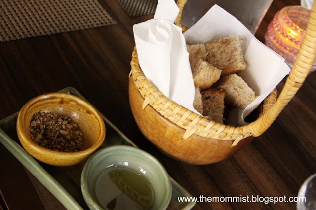 Complimentary bread basket with olive oil and nuts dip