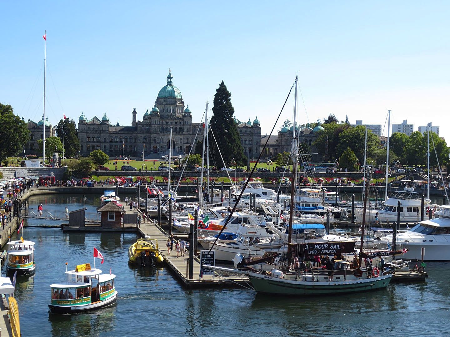 Boats are moored in the inner harbor, downtown Victoria, BC