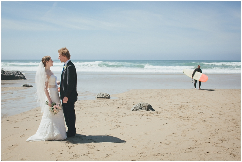 Bride and groom with surfer