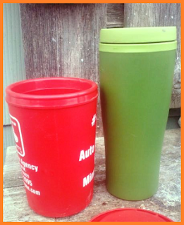 Two thermal mugs: Red 16 ounce mug with handle on left and green 18 ounce mug on right.