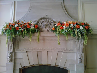 Fireplace mantel at the Cairnwood Estate with flowers by Stein Your Florist Co.