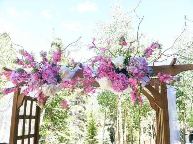 and arch decor for the outside wedding ceremony location at the Mountain
