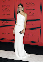 Alessandra Ambrosio white skirt and backless top on the red carpet