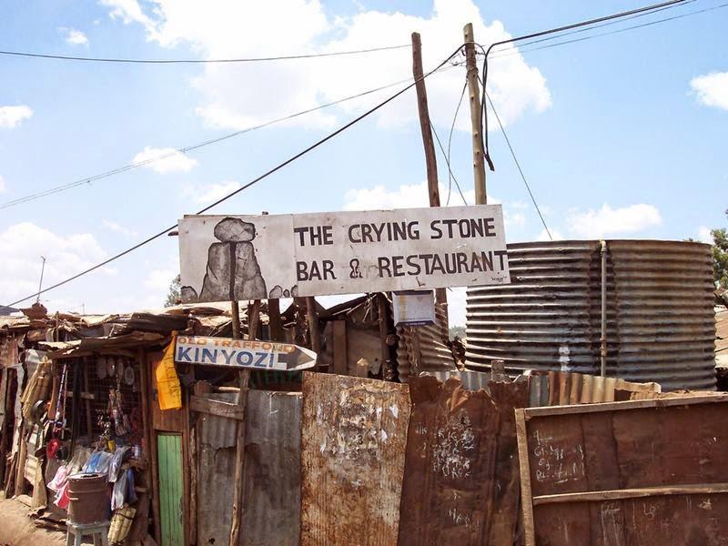 Kibera, The Nairobi neighborhood of Kibera, Africa's largest urban slum, in which around 1 million people live in close-packed tin shacks.