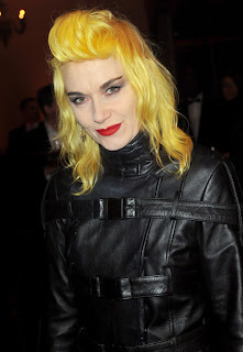 Pam Hogg with yellow hair wearing black leather jacket