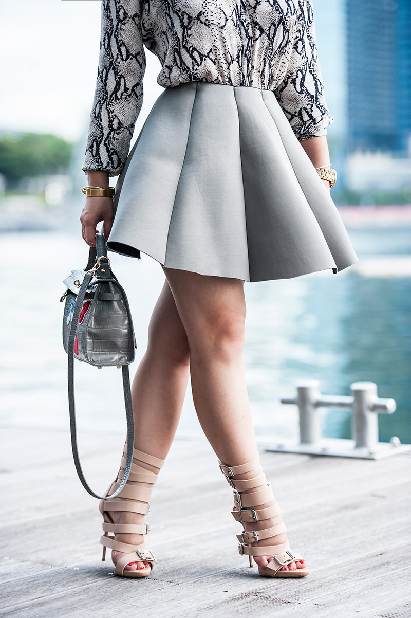 Crystal Phuong- Grey flouncy skirt and gladiator sandals