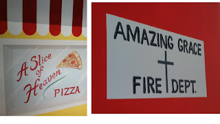 two signs on mural: pizza and fire dept.
