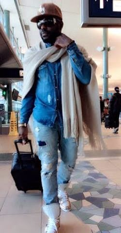 Jim Iyke steps out in distress jeans