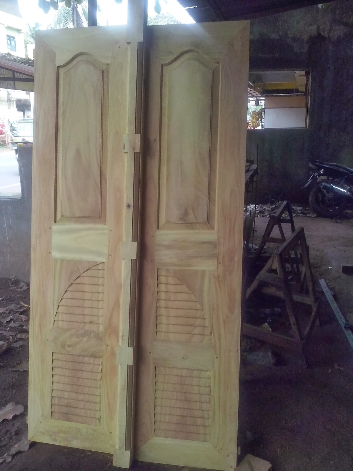 Bavas wood works for Main two door designs